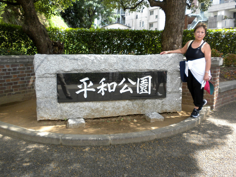 Nagasaki, Japan - Beverly at the entrance to the Peace Park, which memorializes victims of the atomic blast