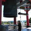 Keelung, Taiwan - Beverly with the big tolling bell of Keelung Buddhist Monastery