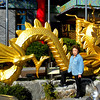 Inchon, Korea - Beverly with the dragon at the entrance of the Korean Chinese Cultural Center