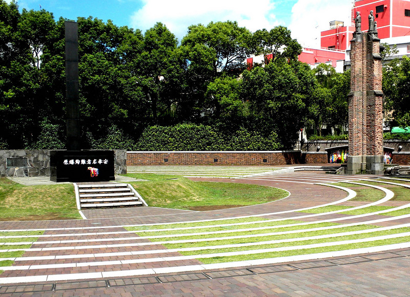Nagasaki, Japan - The memorial indicating the hypocenter of the atomic blast.  On the right is the structural remains of Urakami Cathedral (Catholic).
