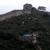 Beijing, China - the Great Wall overlooking the public bathroom (structure with the blue canopy)