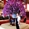 Taipei, Taiwan - Beverly by the orchid arrangement inside Grand Hotel