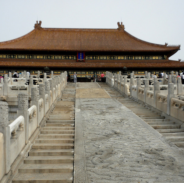 "Beijing, China - stone caring dividing the steps is part of the ""Dragon Vein"" (龍胍) that traverses the entire length of the Forbidden City.  If the Vein is broken, then the dynasty is believed to also coming to an end."