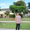 Our old house in Boca Raton, with the mango tree we planted in the backyard nice and big and bearing fruit.