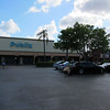 The parking lot of the little mall near our old house.  Seems so tiny now.