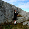 Halifax, Nova Scotia - a bagpiper at Peggy's Cove
