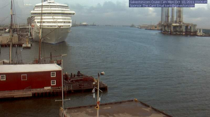 "View from galveston.com ""Cruise Cam"" from the Harbor House Hotel. CARNIVAL TRIUMPH is awaiting us for our five night cruise."
