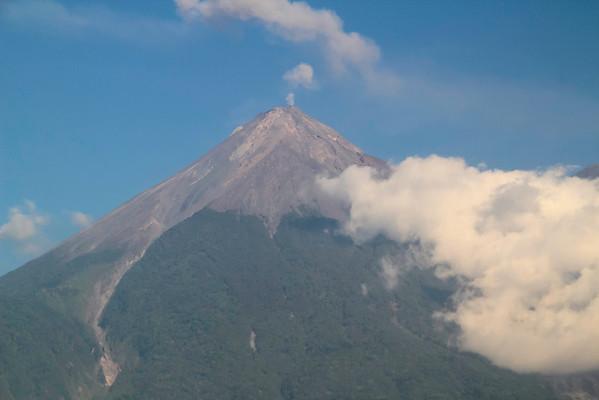 Volcán de Fuego near Antigua, Guatemala (Shot through the window of a moving bus.)