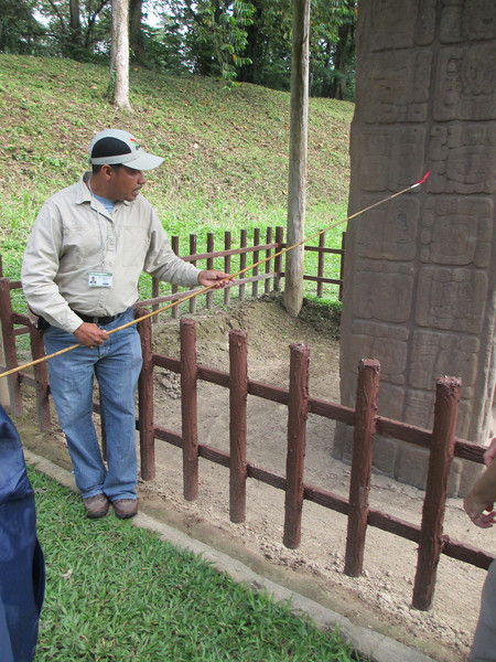 Local guide explains the history of Mayan culture recorded on stellae.