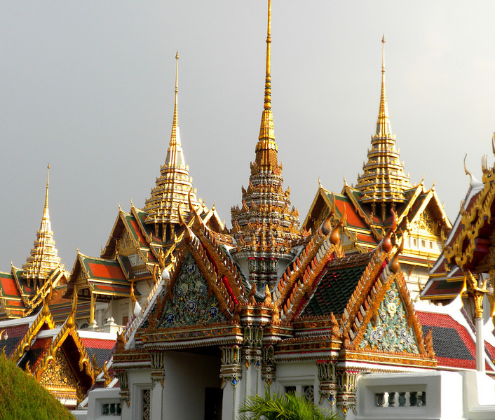Bangkok, Thailand - another fantastic view of sunset light glittering on the golden roofs inside the palace