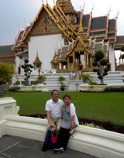 Bangkok, Thailand - Peter and Beverly in front of a building inside the palace