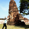 Bangkok - Ayutthaya Historical Park near Bangkok.  Peter was holding up a chedi that was threatening to topple over.