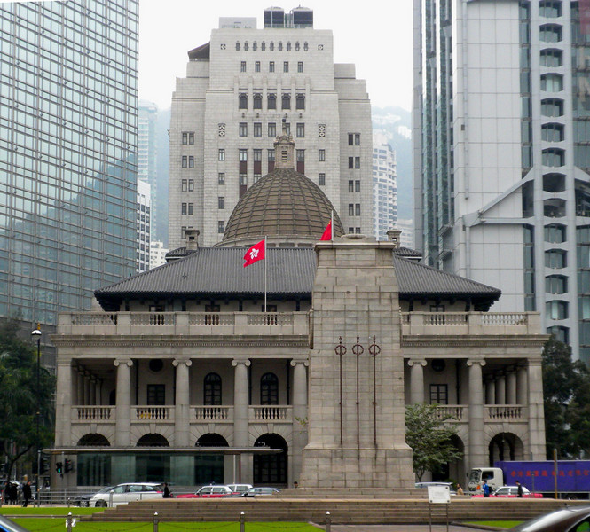 Hong Kong, China - two old landmark buildings flanked by two giant modern buildings