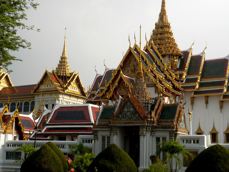 Bangkok, Thailand - fantastic view sunset light glittering on the golden roofs inside the palace
