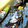Bangkok, Thailand - this lady sells fruit from her boat in the water market