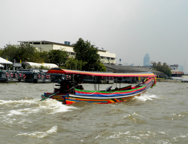 Bangkog, Thailand - one of many colorful river craft