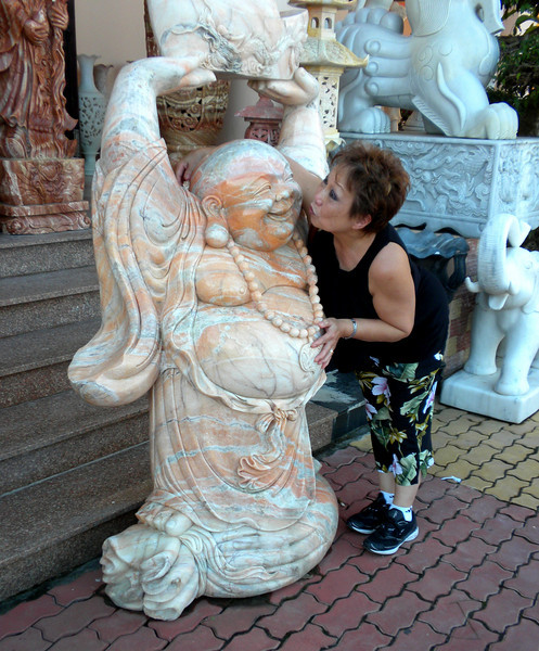 Danang, Vietnam - Beverly meeting a new friend inside a marable carving studio