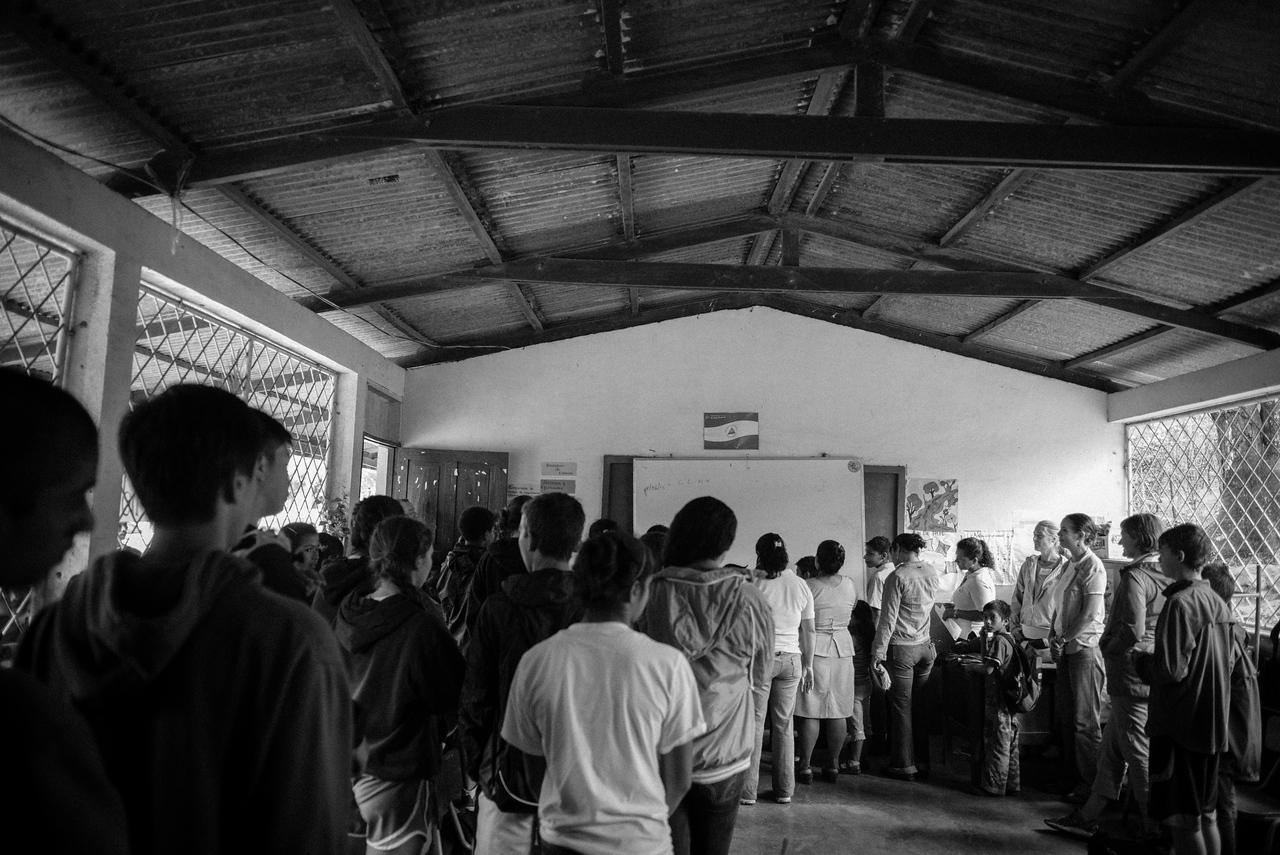 Singing the Nicaraguan national anthem.