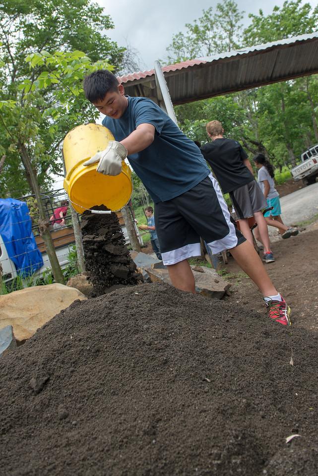 Preparing sand for concrete.