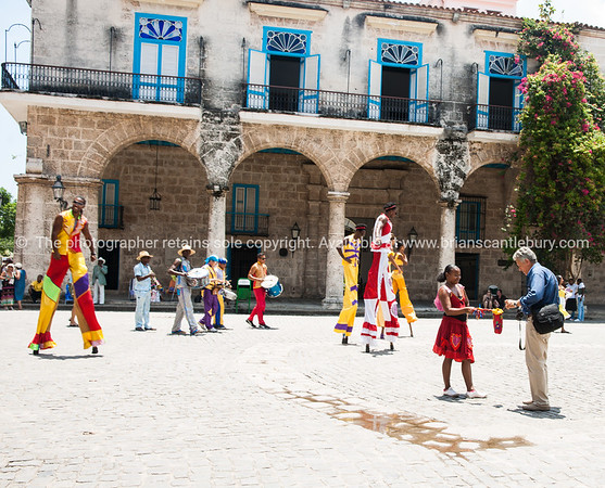 "Havana Images. As the city was in 2012.<br />  Cuba, Havana, street scene. Stilt performers.<br /> Prints & downloads.                also see;  <a href=""http://www.blurb.com/b/3586795-cuba"">http://www.blurb.com/b/3586795-cuba</a>"