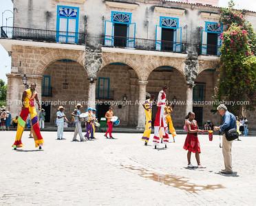 Havana Images. As the city was in 2012.  Cuba, Havana, street scene. Stilt performers. Prints & downloads.                also see; www.blurb.com/b/3586795-cuba