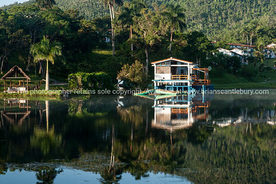 Lake reflections, early morning, La Moka, Cuba. Caves in Pinar Del rio. Prints & downloads.                also see; www.blurb.com/b/3586795-cuba
