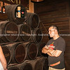 Guide in Havana Club famous rum distillery explans the process to attractive female tourist.