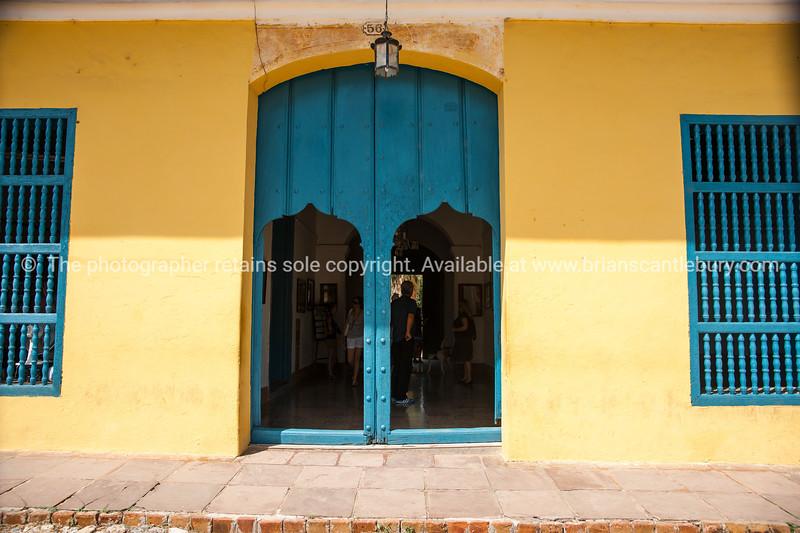 "Cuba, Trinidad, street scene.Blue door  and windows and yellow wall.<br /> Prints & downloads.                also see;  <a href=""http://www.blurb.com/b/3586795-cuba"">http://www.blurb.com/b/3586795-cuba</a>"