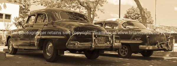 American vintage cars at la Moka, Cuba, monochrome, sepia. Cuba, Trinidad, street scene. Prints & downloads.                also see; www.blurb.com/b/3586795-cuba