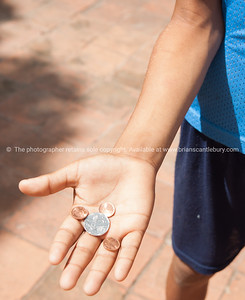 This all I have, coins in a boys hand. Cuba,   Prints & downloads.                also see; www.blurb.com/b/3586795-cuba