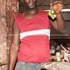 """Vendor holds produce up in the Four Caminos Market. Havana, Cuba.<br /> Boats at Casa de Botes, La Moka.<br /> Prints & downloads.<br /> Model release; no.                also see;  <a href=""""http://www.blurb.com/b/3586795-cuba"""">http://www.blurb.com/b/3586795-cuba</a>"""