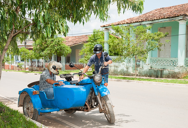 """Old blue motoircycle and sidecar get the kick start.<br /> Caves in Pinar Del rio.<br /> Prints & downloads.                also see;  <a href=""""http://www.blurb.com/b/3586795-cuba"""">http://www.blurb.com/b/3586795-cuba</a>"""