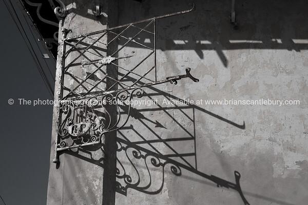 "Cuba, Trinidad, street scene.<br /> Iron frame cast shadow in black & white (monochrome)<br /> Prints & downloads.                also see;  <a href=""http://www.blurb.com/b/3586795-cuba"">http://www.blurb.com/b/3586795-cuba</a>"
