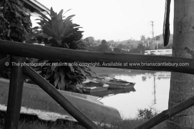 "Lake at La Moka, through ""Casa de Botes"" wooden railing, monochrome. Cuba, Trinidad, street scene. Prints & downloads.                also see; www.blurb.com/b/3586795-cuba"