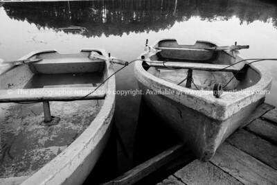 """Row boats at """"Casa de Botes"""", La Moka, Cuba. Monochrome. Cuba, Trinidad, street scene. Prints & downloads.                also see; www.blurb.com/b/3586795-cuba"""