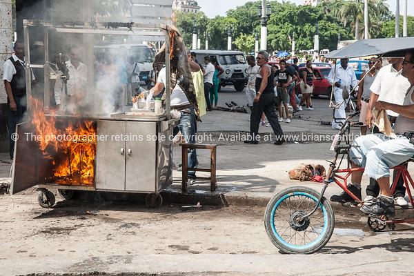 "Cuba, Havana, street scene. Fodd vendors fire.<br /> Prints & downloads.                also see;  <a href=""http://www.blurb.com/b/3586795-cuba"">http://www.blurb.com/b/3586795-cuba</a>"