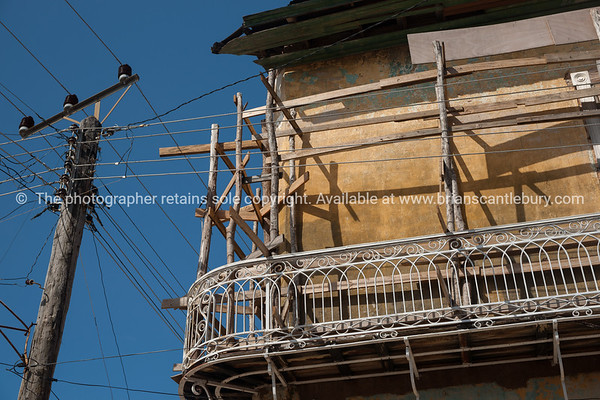 """Cuba, Trinidad, street scene. Old wooden scaffolding and the power lines seem to mix in a dangerous looking work and safety cocktail.<br /> Prints & downloads.                also see;  <a href=""""http://www.blurb.com/b/3586795-cuba"""">http://www.blurb.com/b/3586795-cuba</a>"""