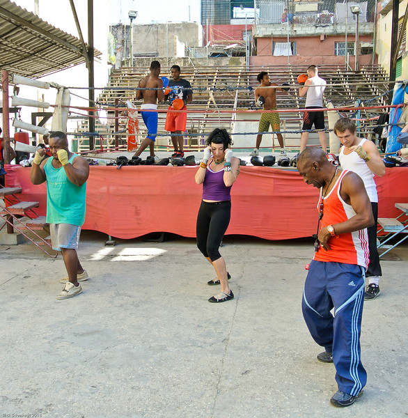 Boxing is a big sport in Cuba.  Here a coach is teaching footwork and stances to some new recruits.