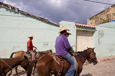 Cowboys riding the streets of Trinidad.