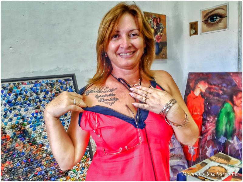 Art School Faculty Member reveals children's names in her tattoo