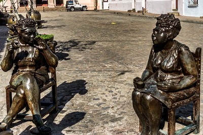 Two of the gossiping ladies statues by Martha Jimenez in Carmen Square, Camaguey.