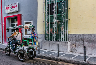 Street scene near our hotel in Camaguey.  One of many bici-taxis.