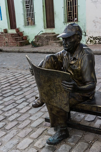 And a gentleman enjoying his newspaper and the square.