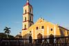 Iglesia San Juan Bautista de Remedios church in Remedios, Cuba. Structure in front for upcoming festival Las Parrandas de Remedios.
