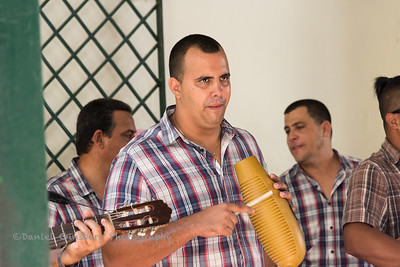 Musician playing a güiro in Havana, Cuba