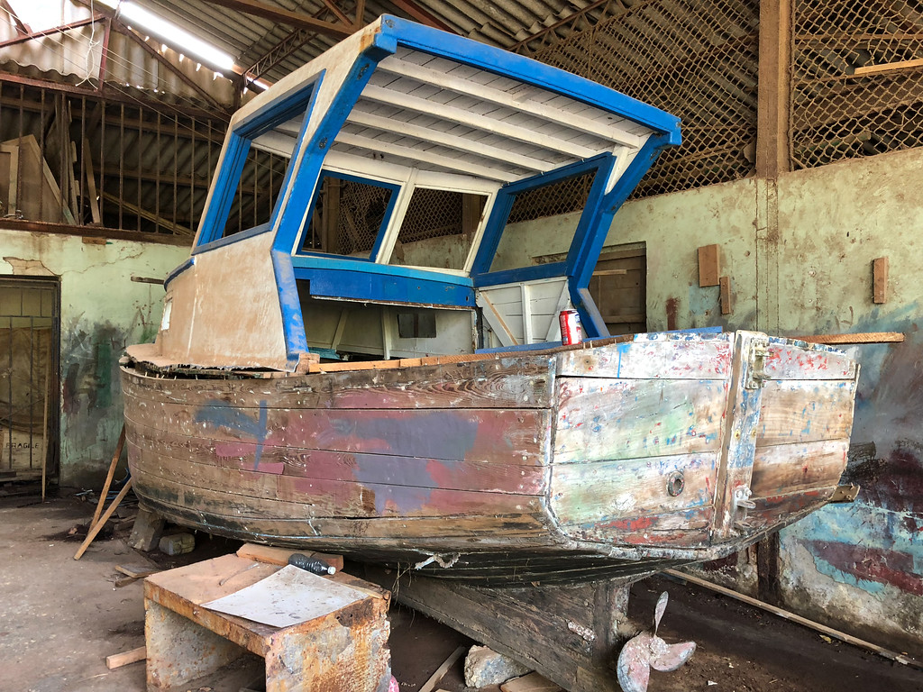 The fishermen are rebuilding this boat from scrap wood washed up after hurricane Irma.