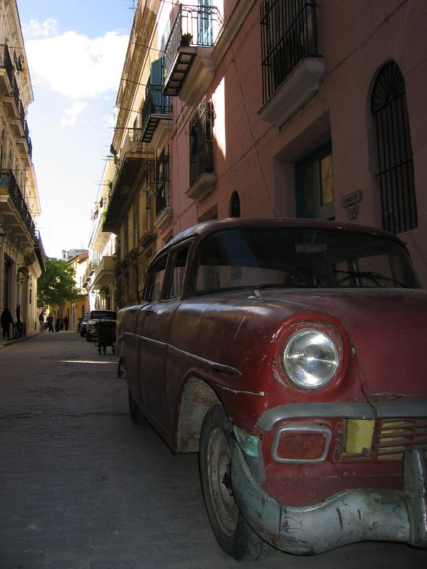 Old fashioned car in city streets alley Havana, Cuba
