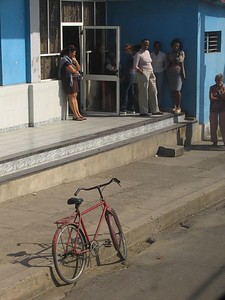 Old bicycle outside bus stop in Cuba