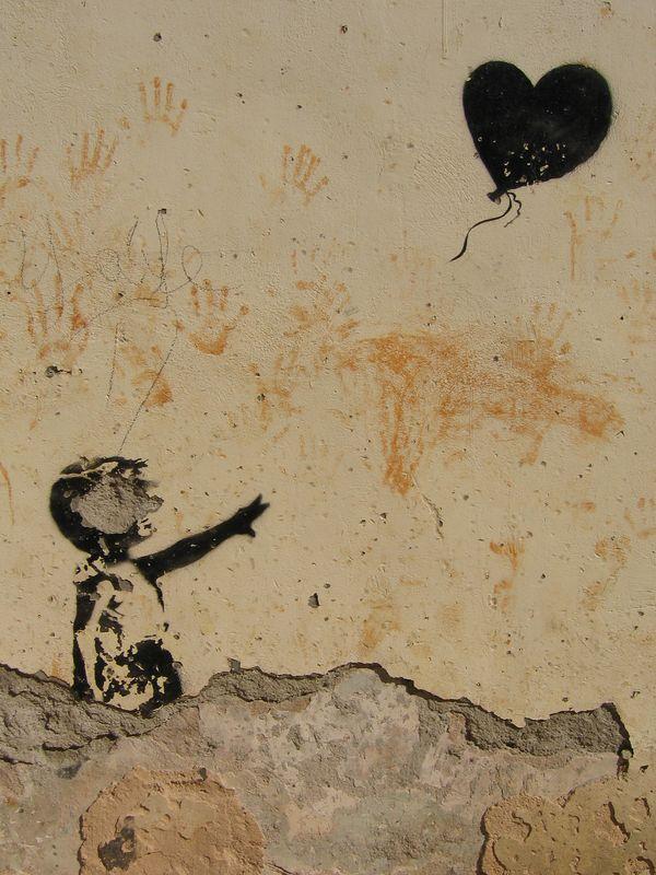 Boy loses balloon wall mural in Havana, Cuba