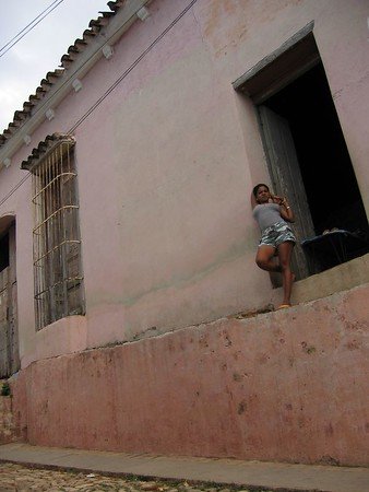 Woman leaning on wall in Trinidad, Cuba